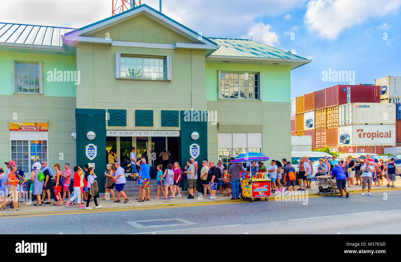 Grand Cayman, Cayman Islands, tourists at George Town port in the Caribbean, queuing to re-embark on their cruise - Stock Image