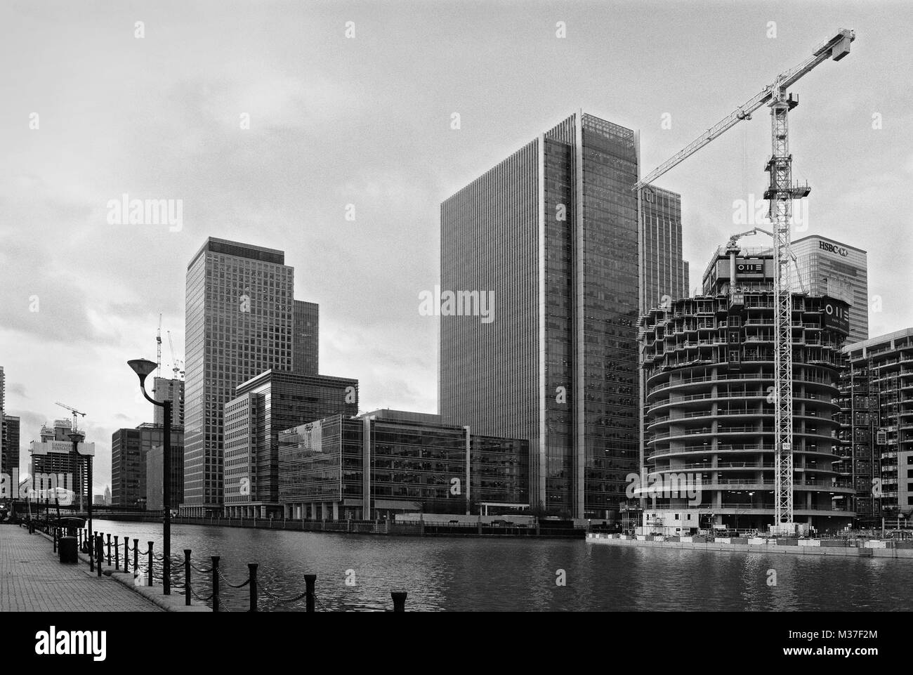South Dock, Canary Wharf, London UK, with buildings under construction - Stock Image