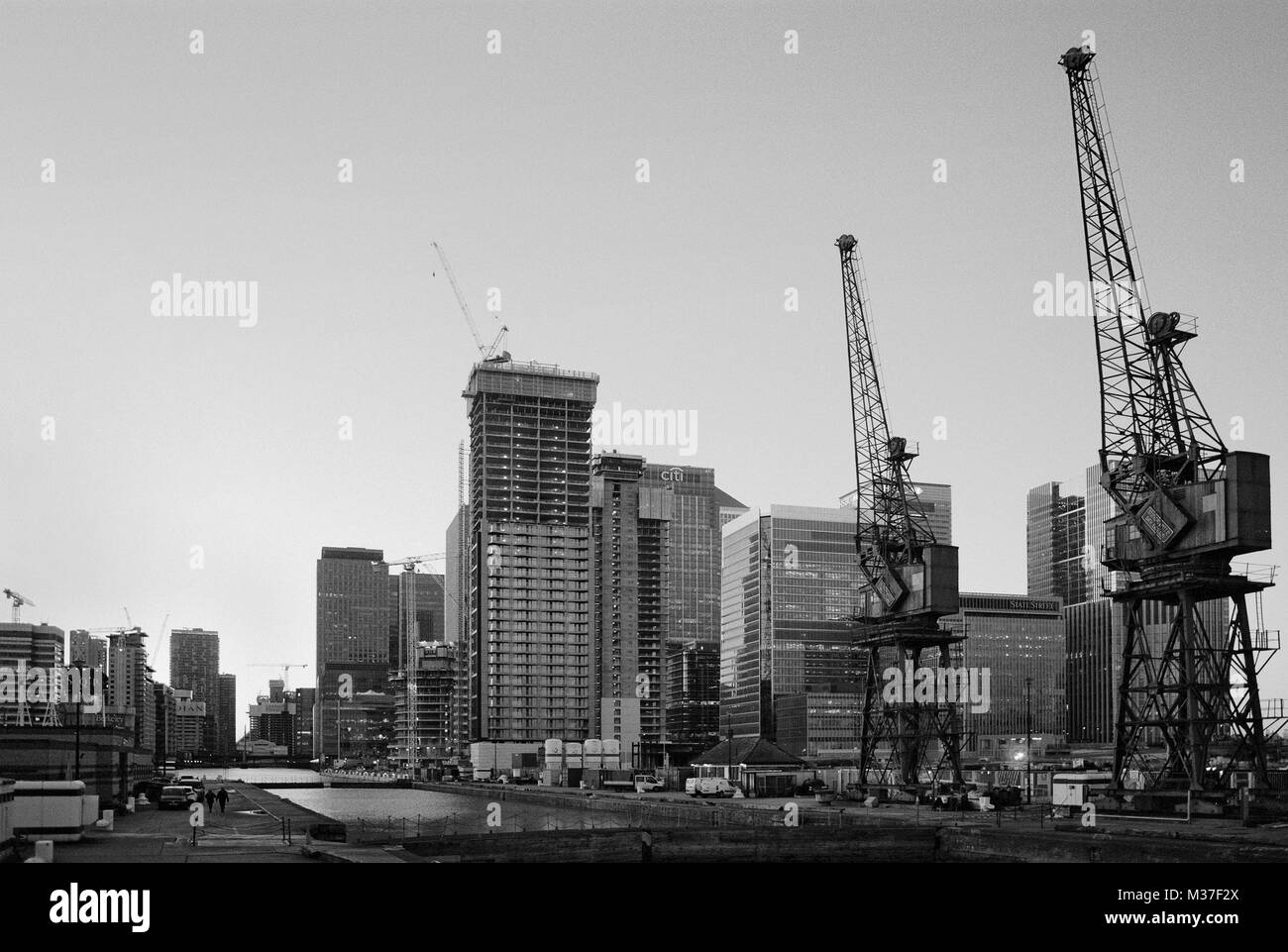 New buildings under construction and cranes at South Dock, Canary Wharf, East London, UK - Stock Image