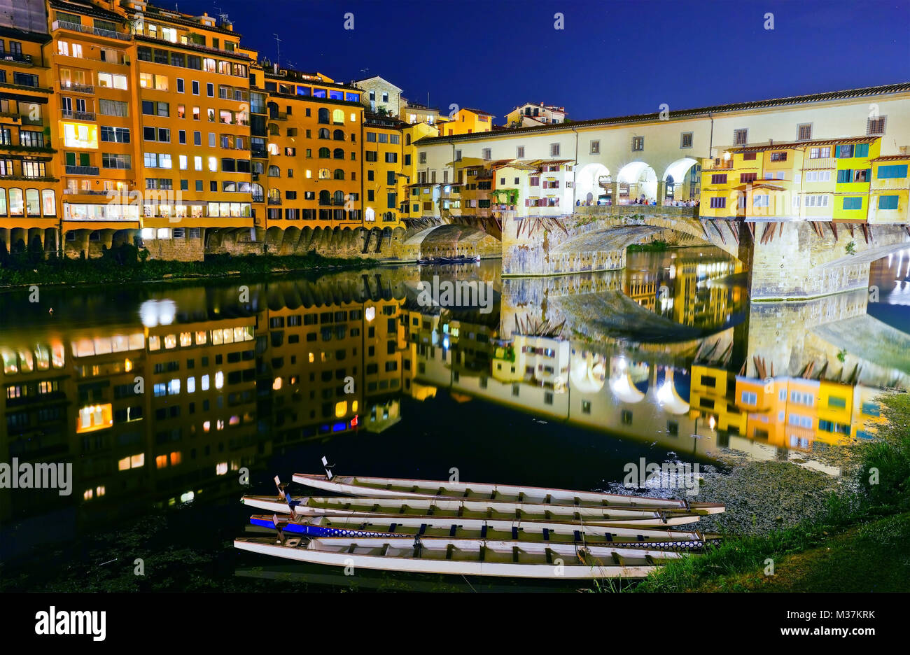 View of the Old Bridge across the Arno River in Florence at night. - Stock Image