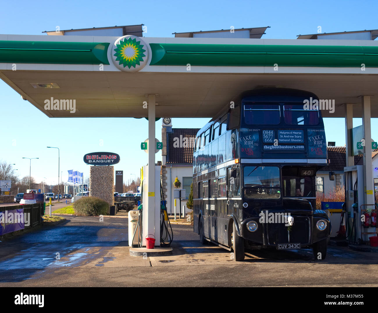 Edinburgh, Scotland / United Kingdom - February 09 2018: A photograph of the Edinburgh Ghost Bus Tour refuelling Stock Photo