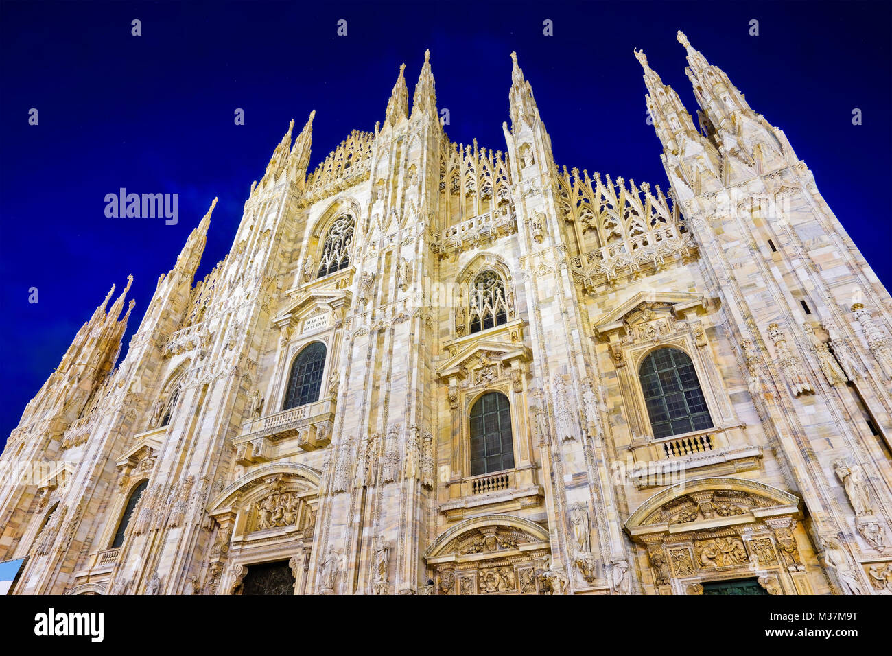 View of the Milan Cathedral at night in Milan, Italy. - Stock Image