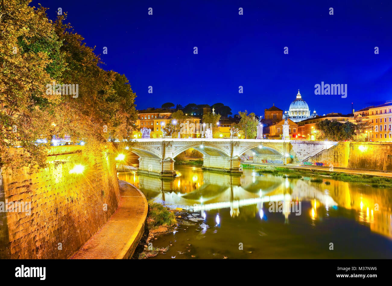 View of St. Peter's Basilica from Aelian Bridge in Rome at night. Stock Photo