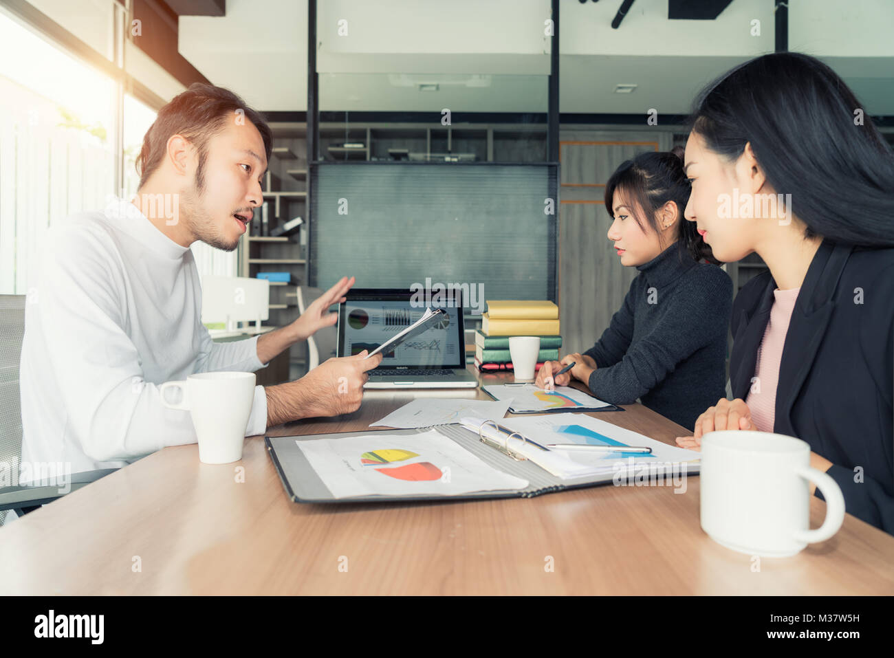 Asian businessman present sell graph at meeting room in office. Business present and meeting concept. - Stock Image