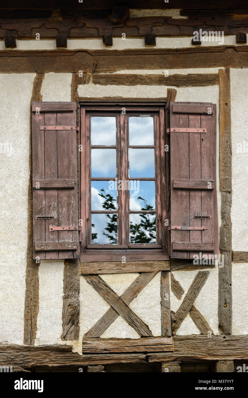 Window With Wooden Shutters On An Old Half Timbered Building