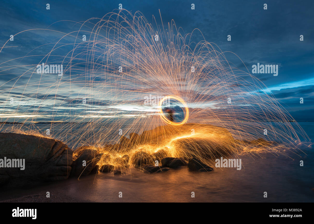 Amazing steel wool coast the sea on the beach in sunset time. Stock Photo