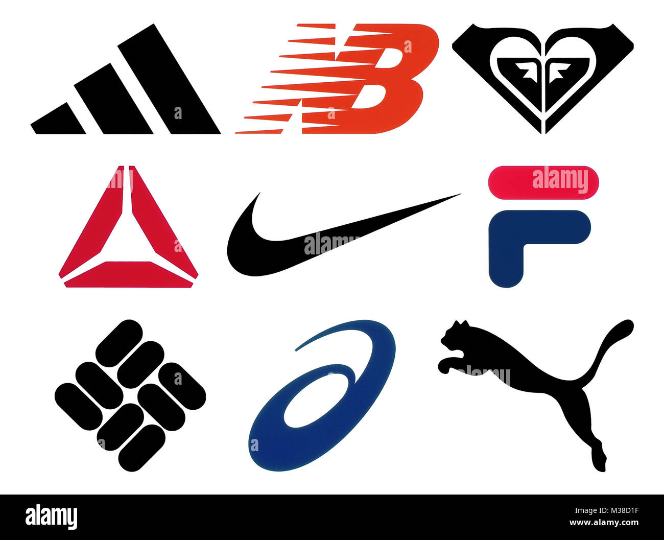 Kiev, Ukraine - October 27, 2017: Set of popular sportswear manufactures logos printed on paper: Adidas, New Balance, Stock Photo