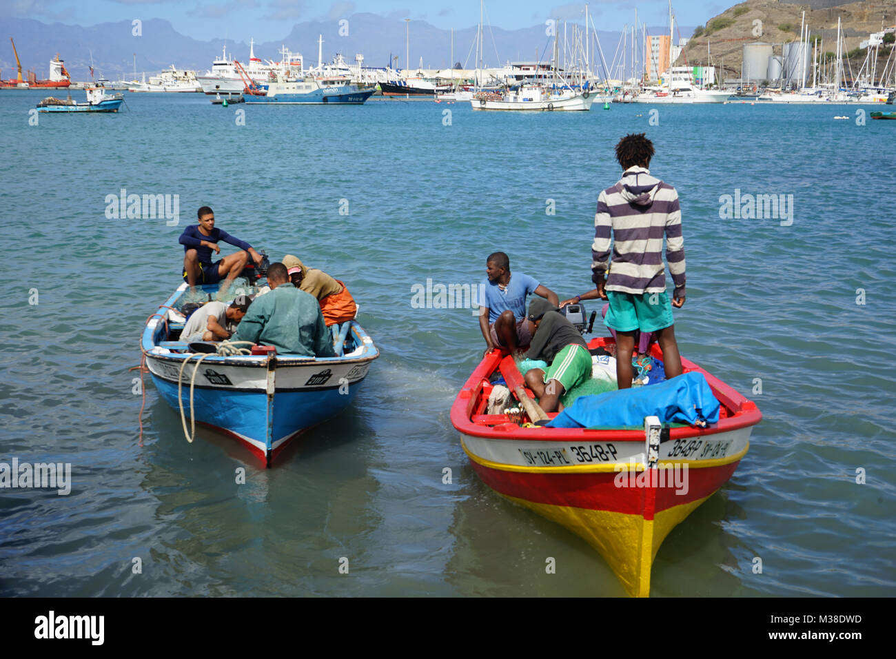 Fishermen unloading Boats, Fish Market, Mindelo, Cape Verde Stock Photo