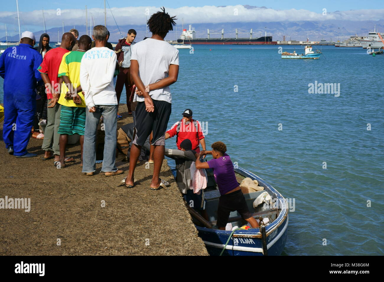 People Watching the Unloading of Fisher Boats in Mindelo, sao Vincente, Cape verde Stock Photo