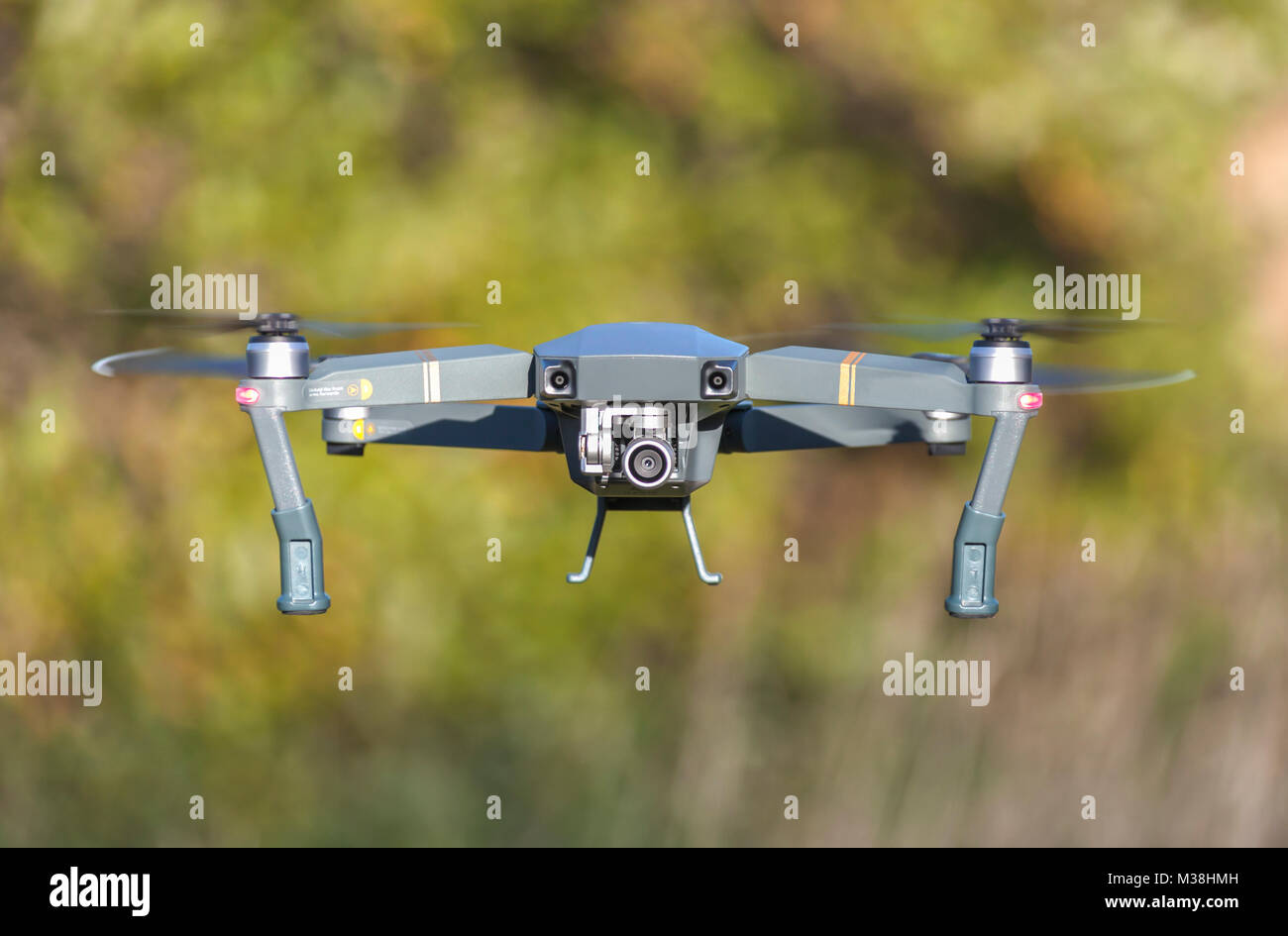 Close up of a drone uav  quadcopter in flight for recreational video and photography use - Stock Image
