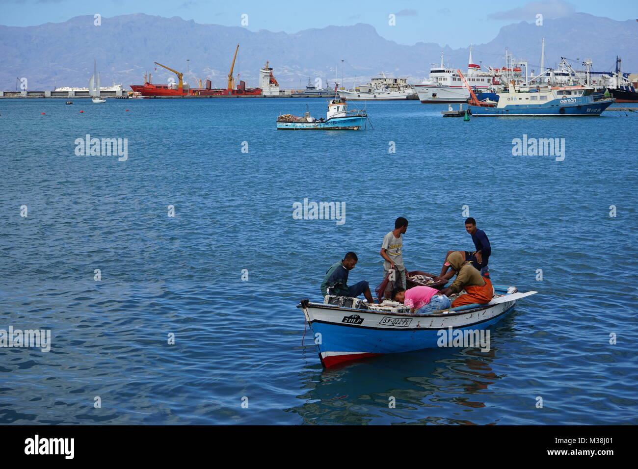 fishermen bringing fish to the fish market in Minelo Stock Photo