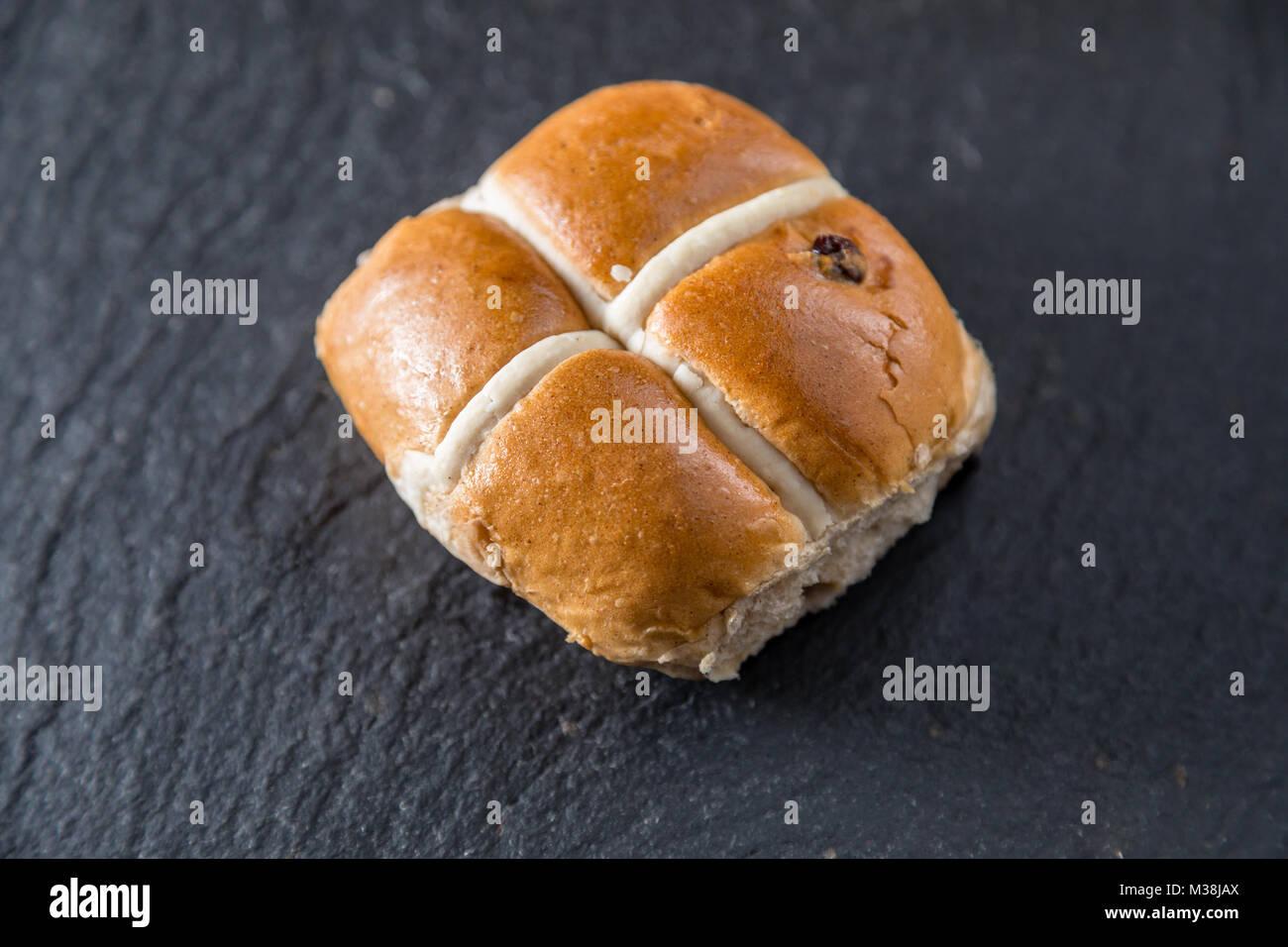 Hot cross bun n a grey slate platter - Stock Image