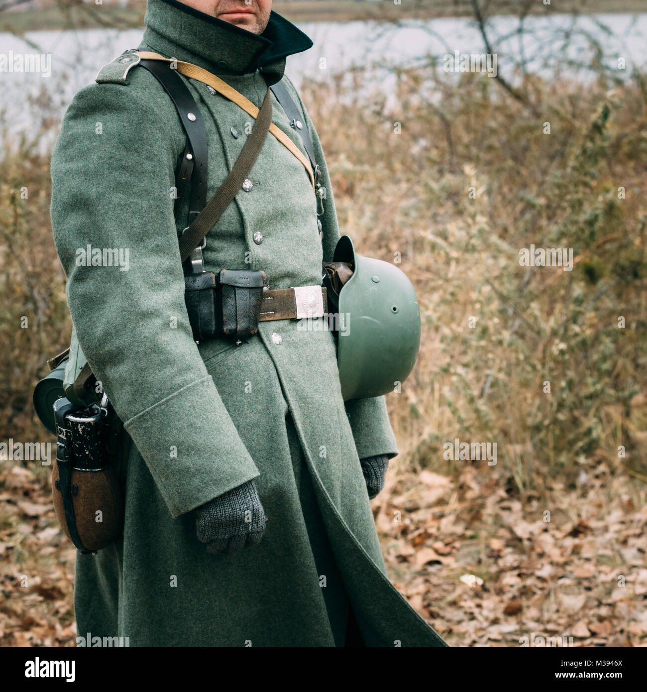 The German soldier in greatcoats and in the form of the times of World War II - Stock Image