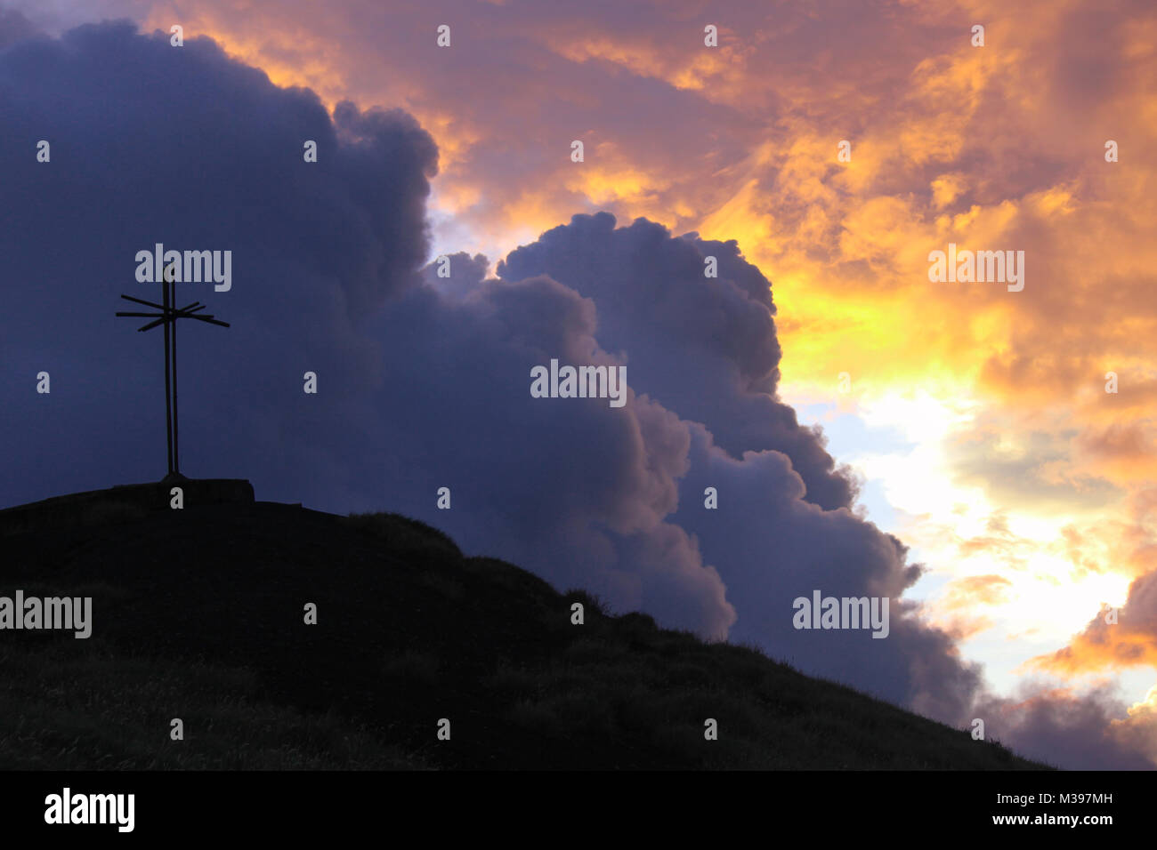 Sunset scene of Masaya volcano cross and gas filled clouds. - Stock Image