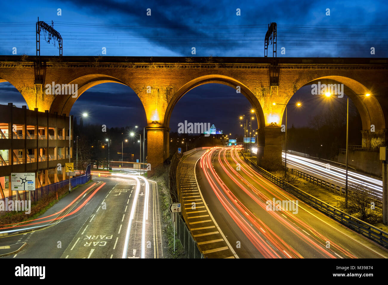 The Stockport Viaduct and M60 Traffic at Night, Stockport, Greater Manchester, England, UK - Stock Image