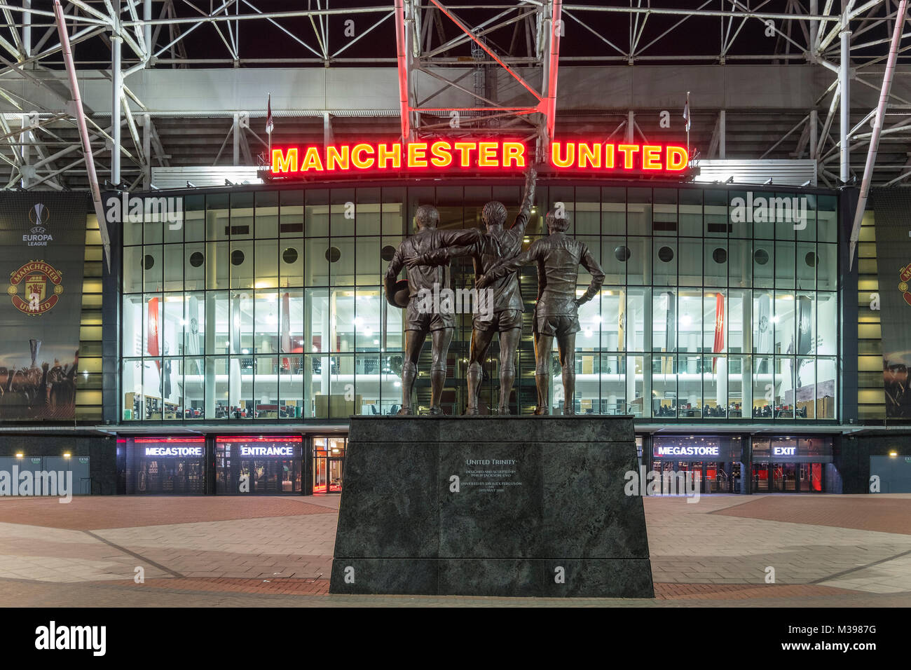 United Trinity Statue in front of Manchester United Football Club Stadium, Old Trafford, Manchester, Greater Manchester, - Stock Image
