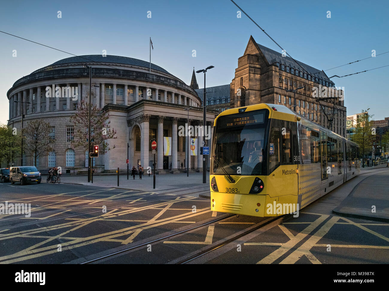 Metrolink Tram passing The Central Library, St Peters Square, Manchester, Greater Manchester, England, UK - Stock Image