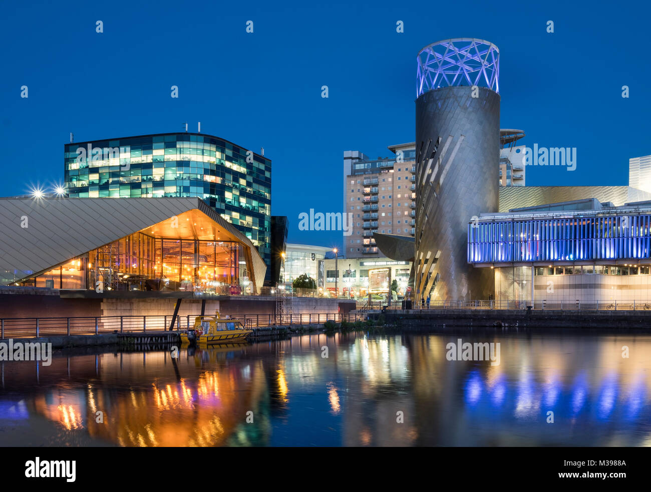 The Alchemist Building and Lowry Centre at night, Salford Quays, Greater Manchester, England, UK - Stock Image