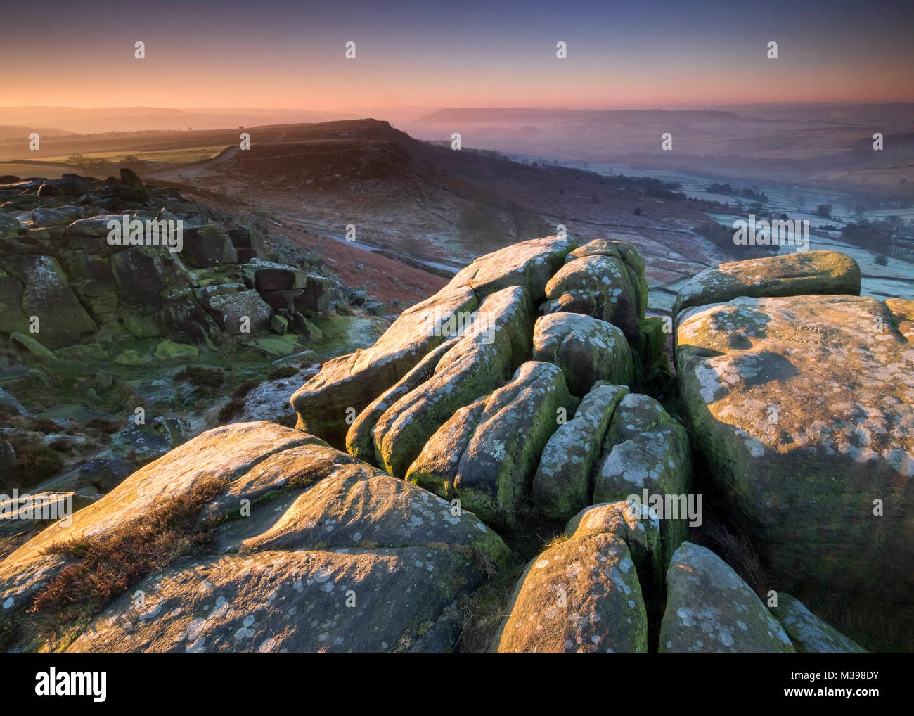 Winters dawn from Curbar Edge, Peak District National Park, Derbyshire, England, UK - Stock Image