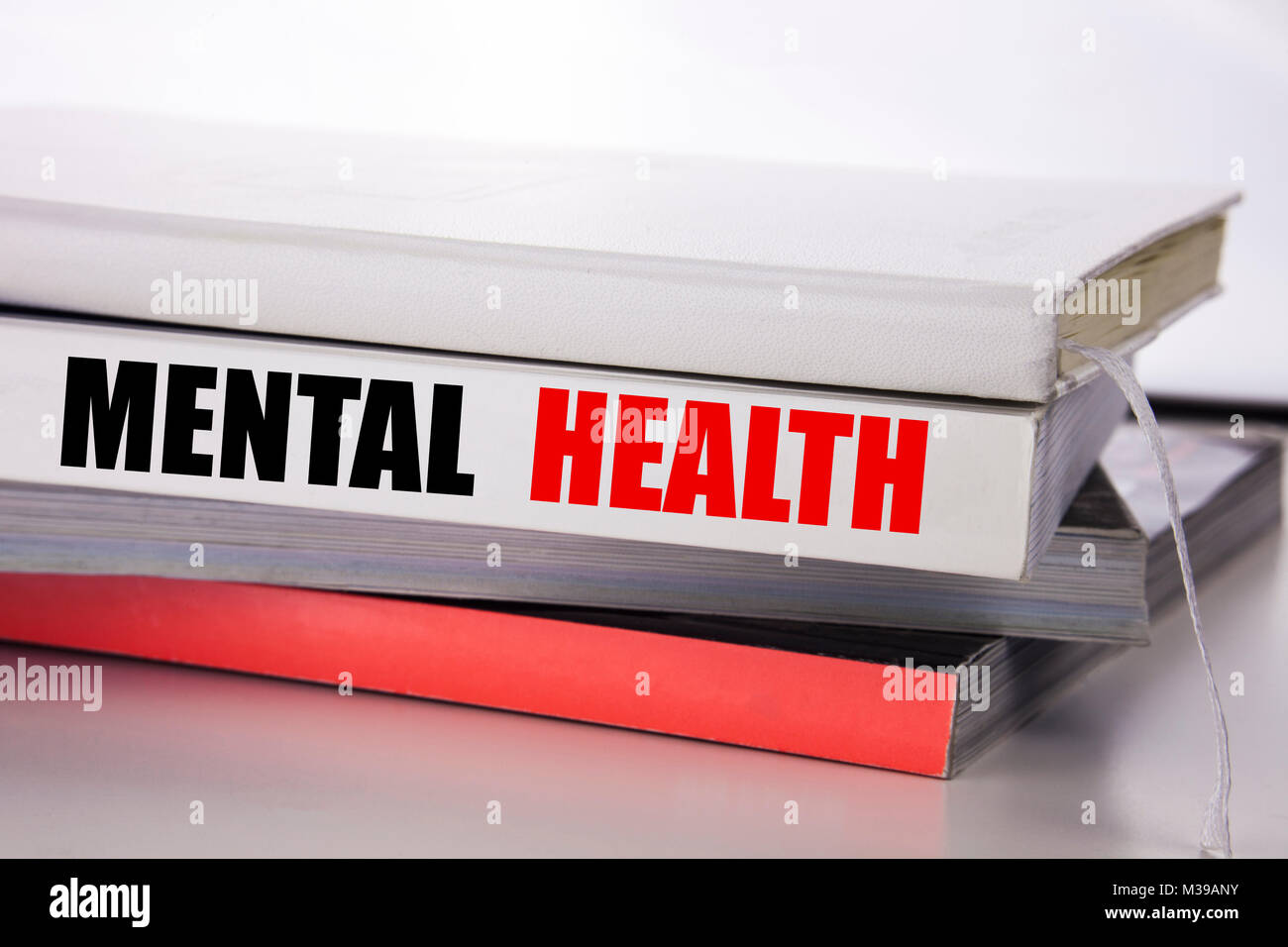 Writing text showing Mental Health. Business concept for Anxiety Illness Disorder written on the book on the white - Stock Image