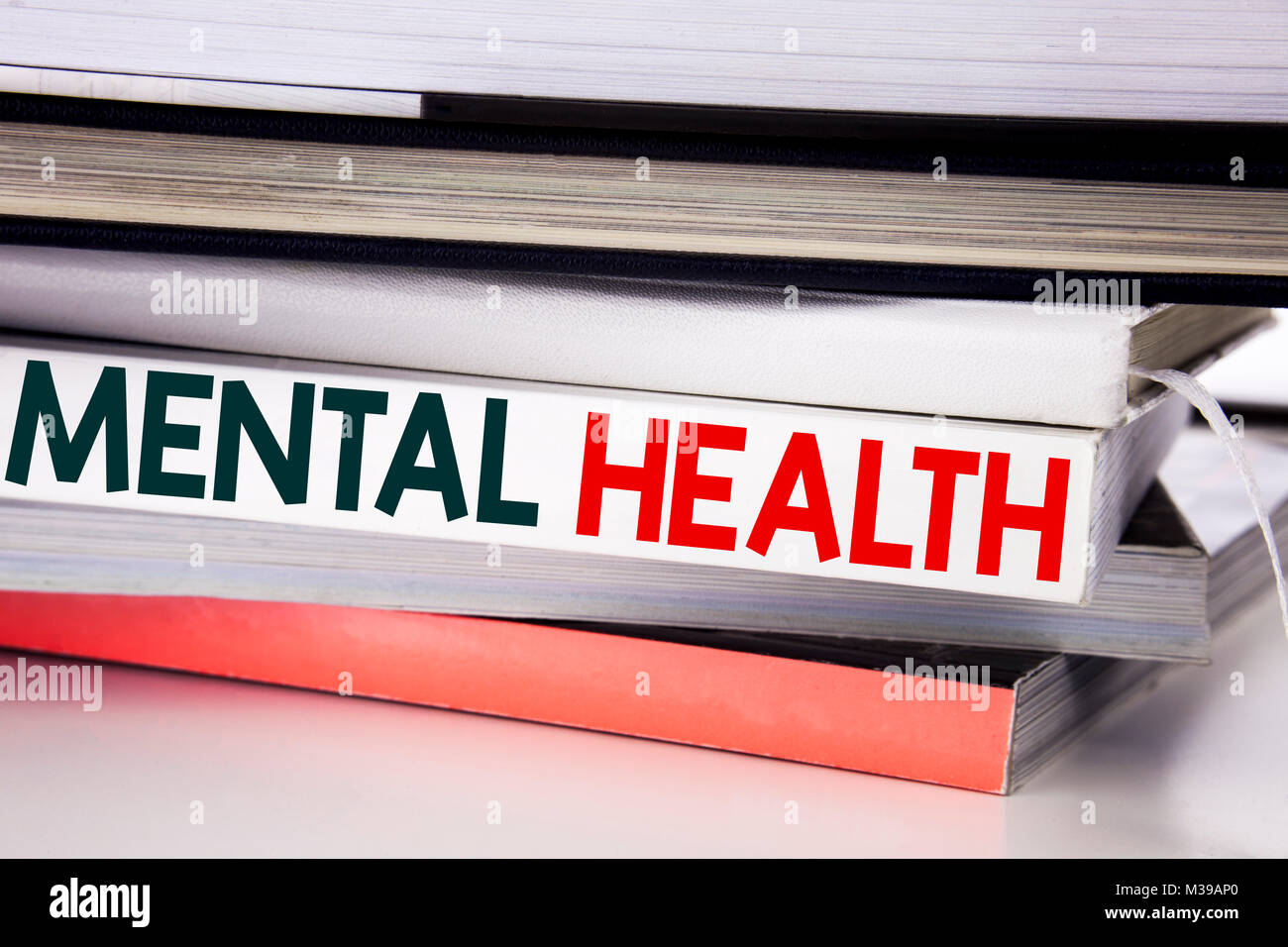 Word, writing Mental Health. Business concept for Anxiety Illness Disorder written on the book on the white background. - Stock Image