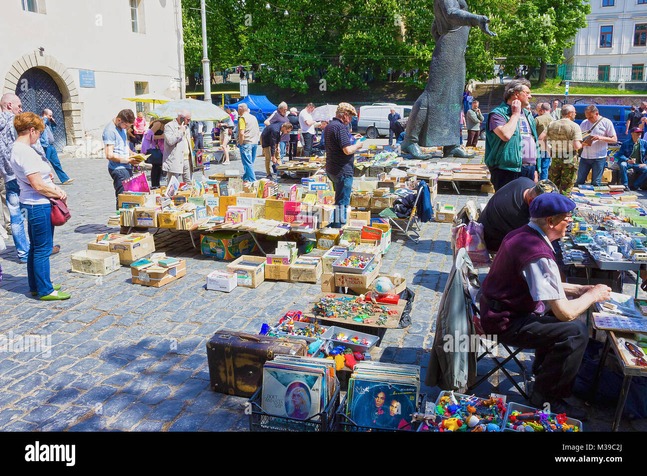 Lviv, Ukraine - May 6, 2017: The stalls of the flea market in Museum square offer different goods - old medals, - Stock Image