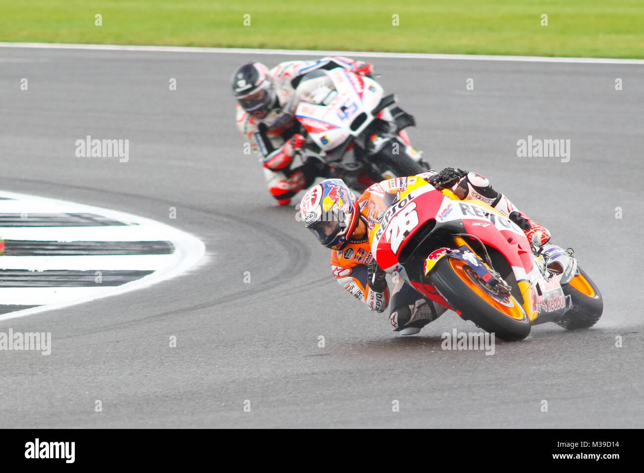Danni Pedrosa Repsol Honda leads Scott Redding on the Pramac Ducati  during MotoGP Qualifying for the British Grand - Stock Image