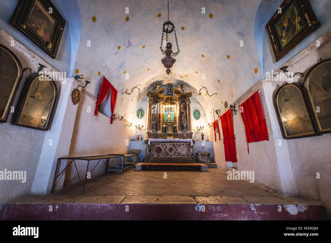 Altar of Church of Our Lady of Remedy on the slope of Saint John mountain above Old Town of Kotor town in Bay of Stock Photo