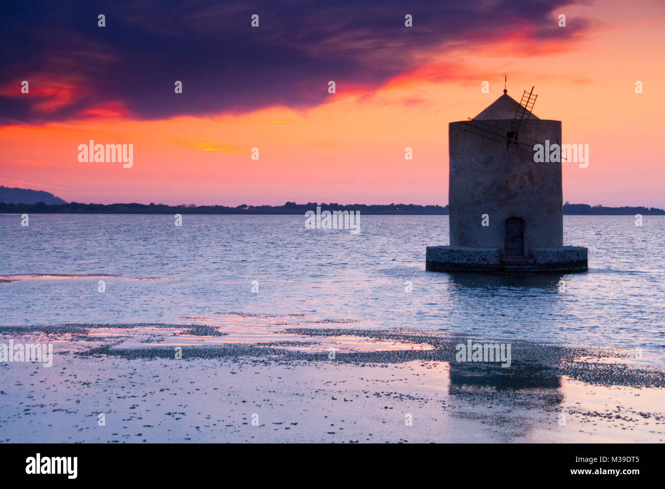 Monte Argentario, Orbetello, Tuscany - A solitary windmill in Orbetello's lagoon, in Tuscany. It is the so-called - Stock Image