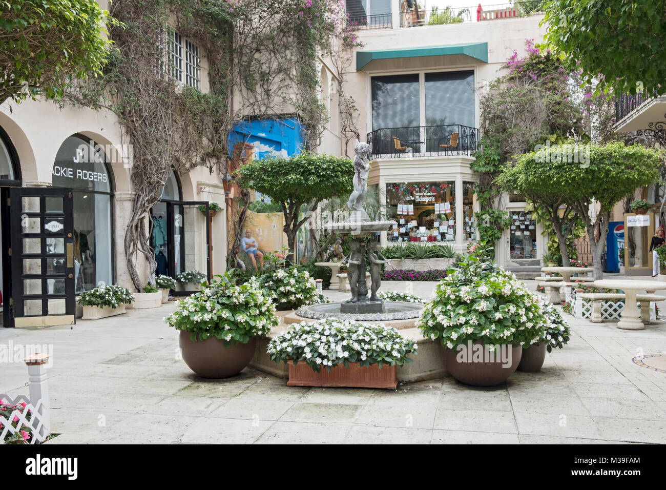 The Via Amore courtyard with its pricey shops in the shopping district off Worth Avenue in Palm Beach Florida. - Stock Image