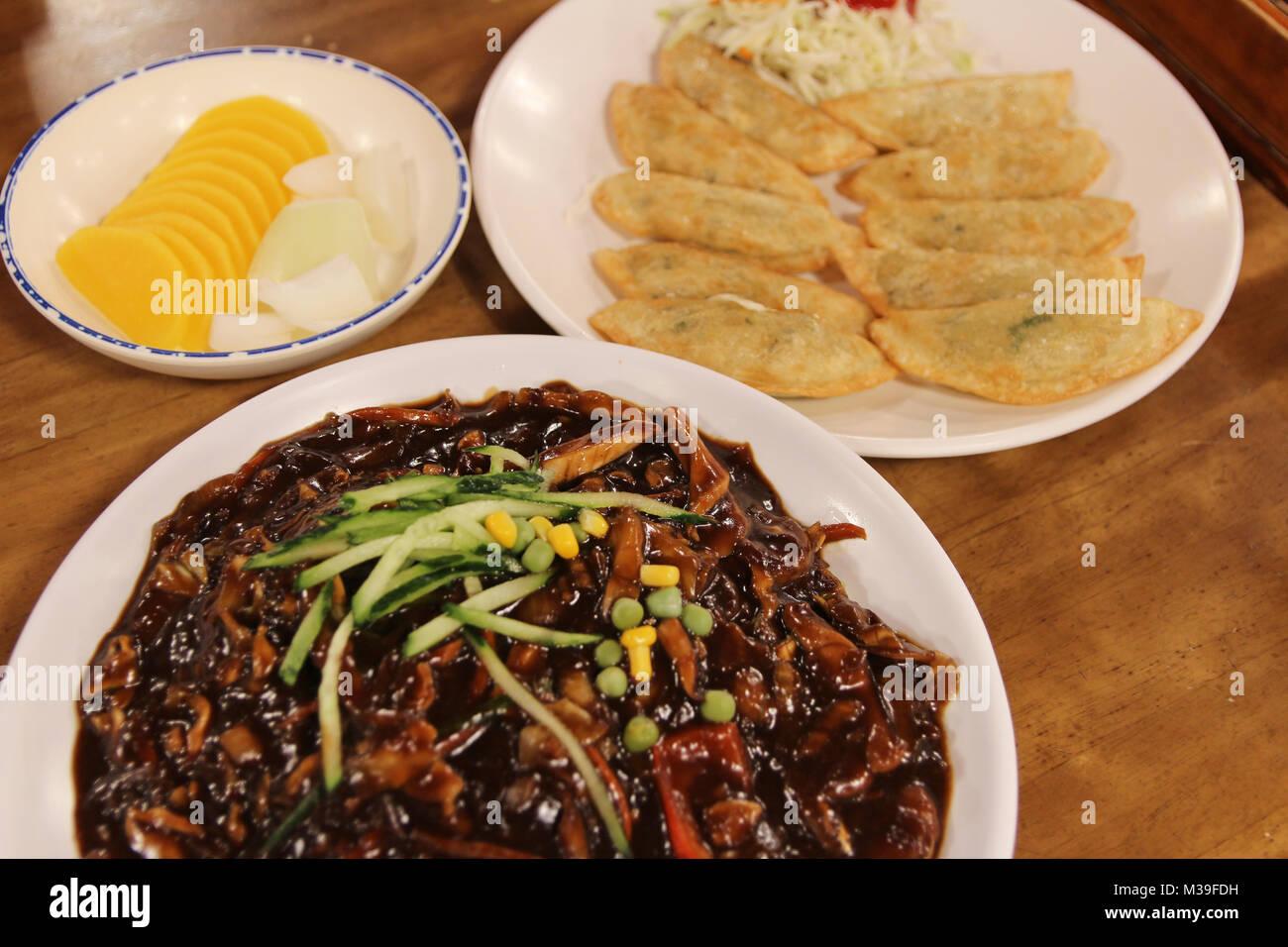 Jajangmyeon, Korean black bean sauce noodles with the fried dumplings and pickled at Korean restaurant, Busan, South - Stock Image