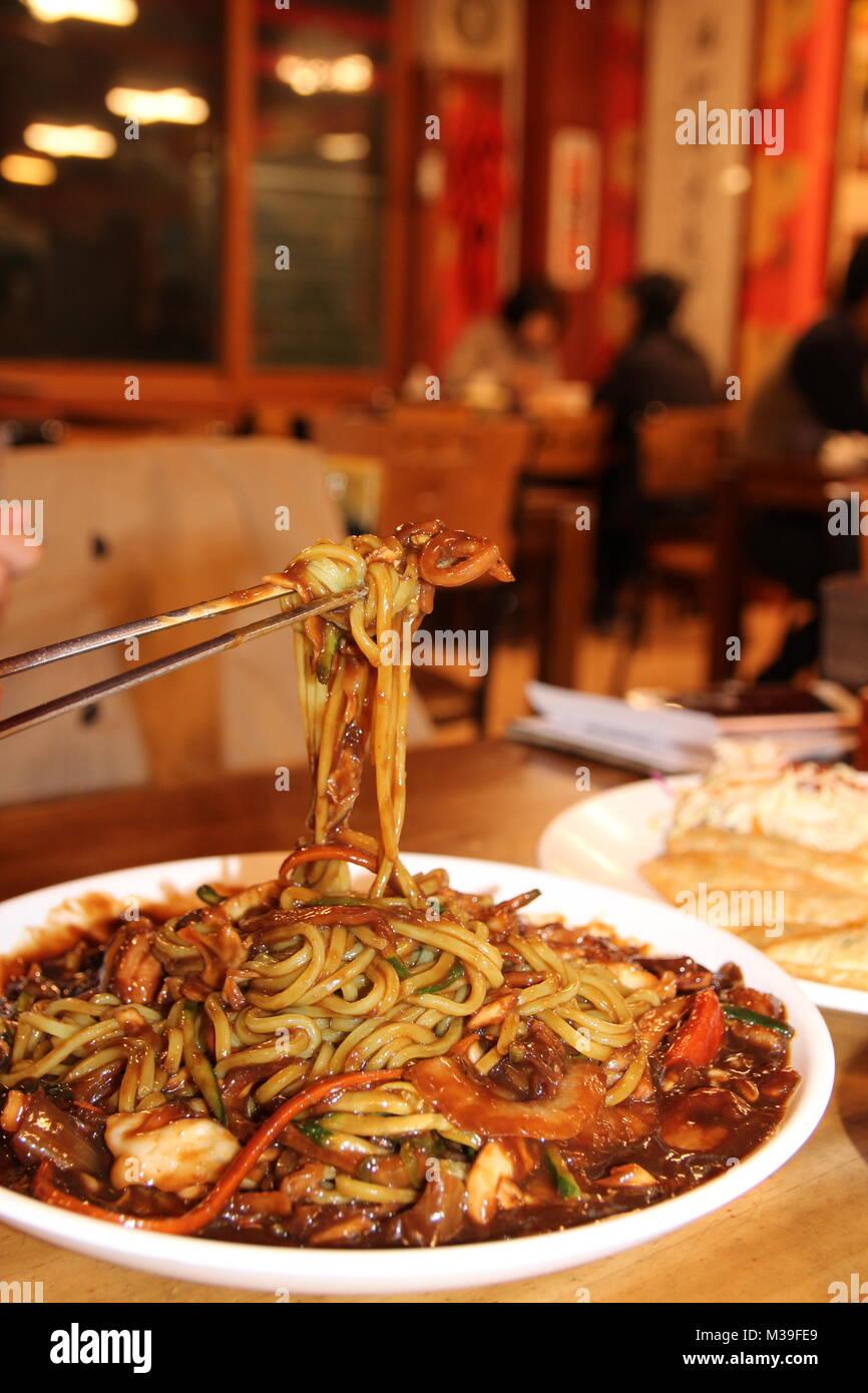 Close up of Jajangmyeon, Korean black bean sauce noodles at Korean restaurant, Busan, South Korea - Stock Image