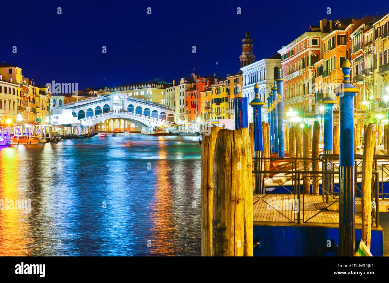 View of the Rialto Bridge and Grand Canal in Venice at night. Stock Photo