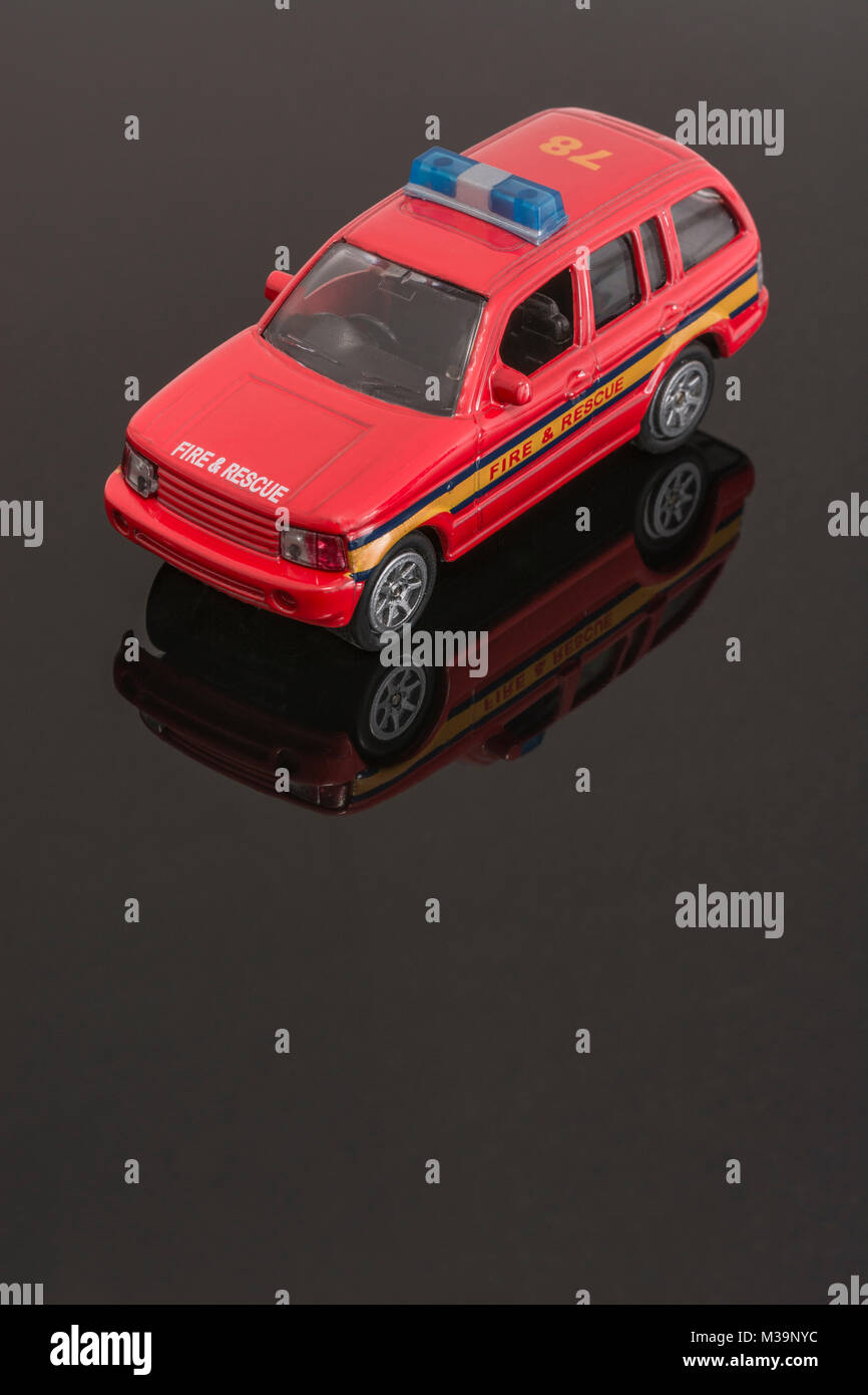 Toy Emergency Services / Fire Brigade vehicle - as metaphor for concept of Emergency Services / First Responders. - Stock Image