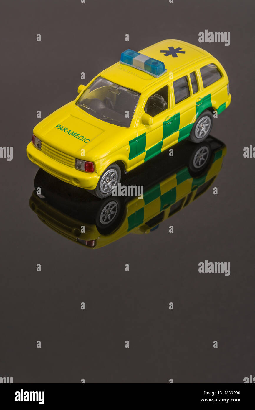 Toy Emergency Paramedic Services vehicle - as metaphor for concept of Emergency Services / First Responders. - Stock Image