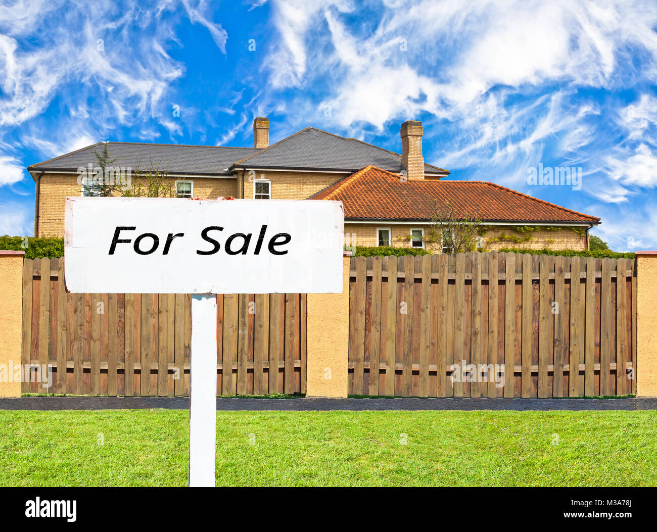 House  for sale behind the fence - Stock Image