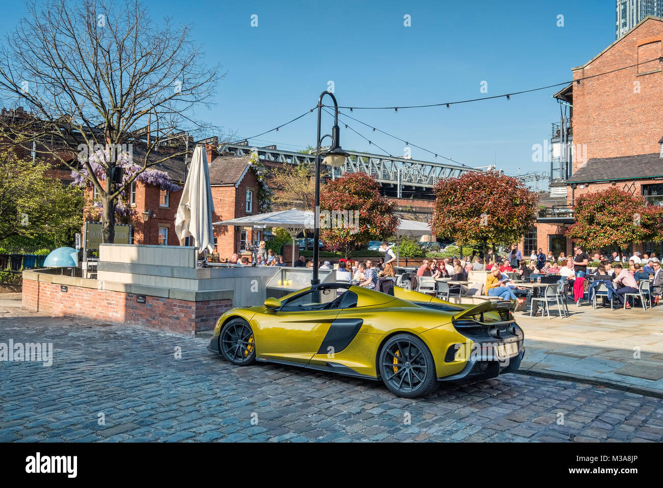 McLaren Sports Car parked outside Alberts Shed Bar and Restaurant, Castlefield, Manchester, Greater Manchester, - Stock Image