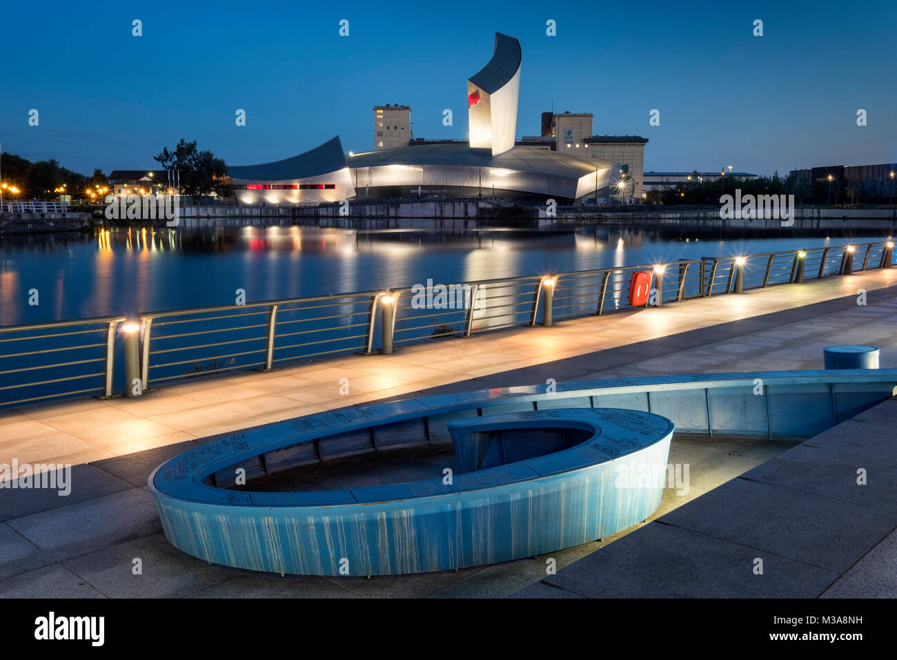 The Imperial War Museum North at night, Salford Quays, Greater Manchester, England, UK - Stock Image