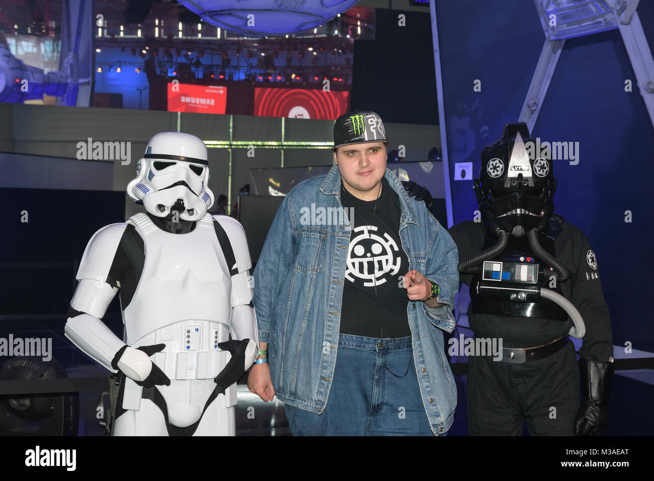 Cologne, Germany - August 24, 2017: A gamer posing with two star wars actors for the game star wars battlefront - Stock Image