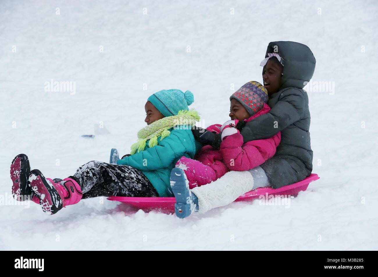 Chicago, USA. 9th Feb, 2018. People enjoy snow at Grant Park in Chicago, the United States, on Feb. 9, 2018. Credit: Stock Photo