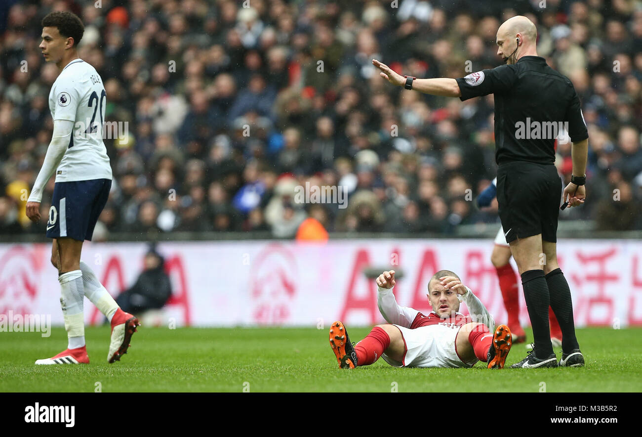 Jack Wilshere of Arsenal is fouled during the Premier League match between Tottenham Hotspur and Arsenal at Wembley - Stock Image