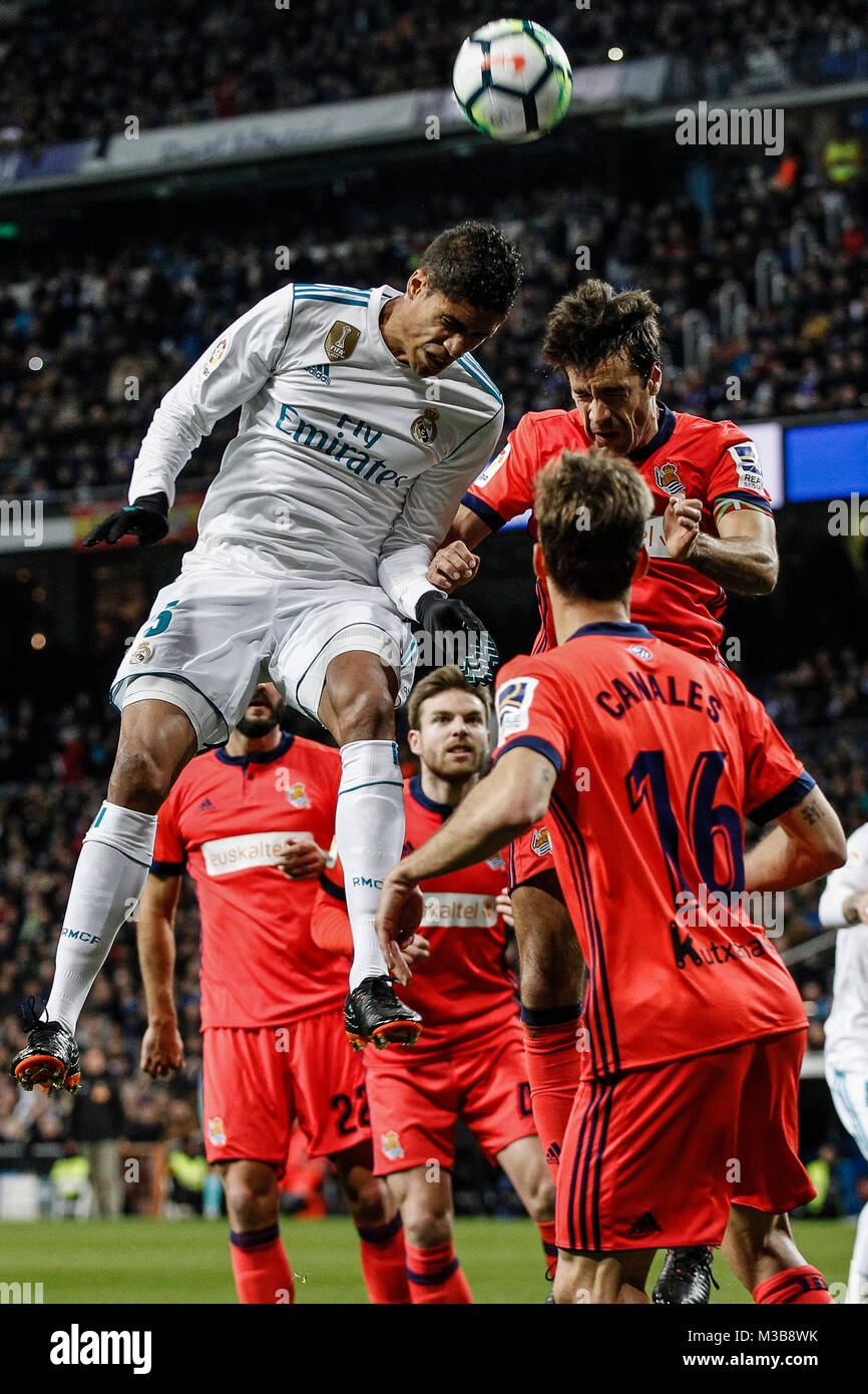 Raphael Varane (Real Madrid) fights for the header with La Liga match between Real Madrid vs Real Sociedad at the - Stock Image