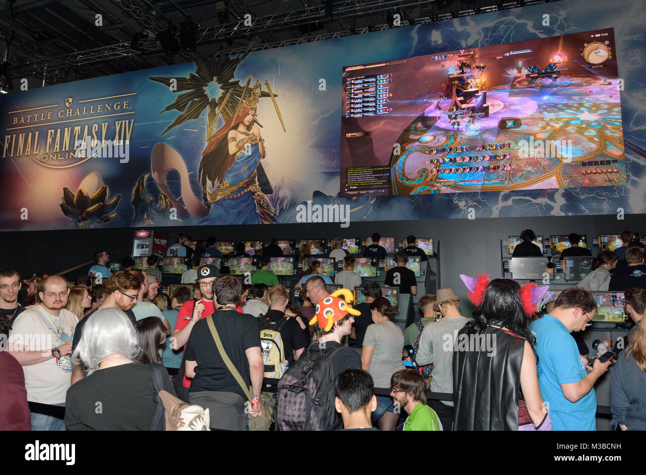 Cologne, Germany - August 24, 2017: Trade fair visitors waiting and playing the game final fantasy 14 at Gamescom - Stock Image