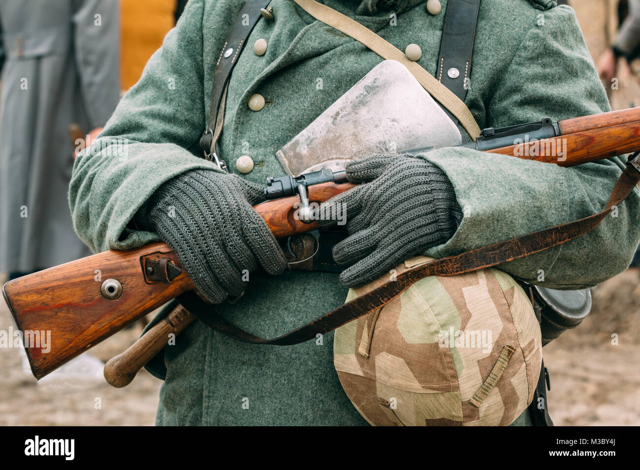 The uniform and outfit of a German soldier with a rifle during the Great Patriotic War. Reconstruction Stock Photo