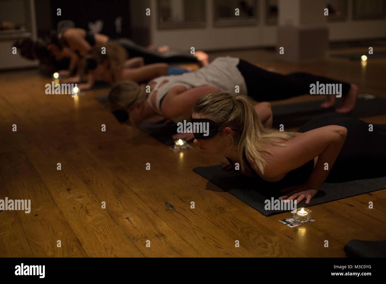 Blindfolded yoga class, London, England UK Stock Photo