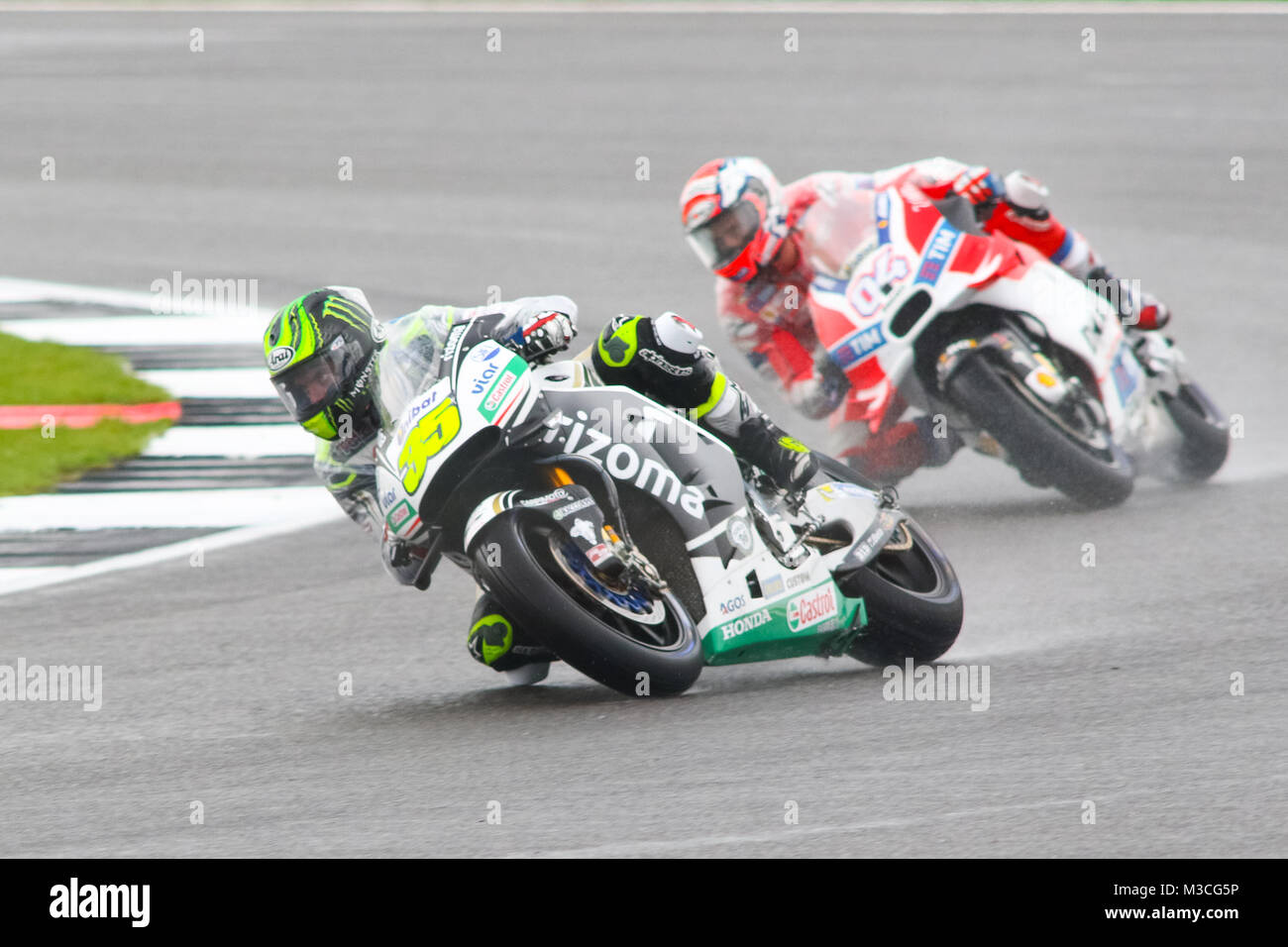 Cal Crutchlow leads Andrea Dovizioso during wet MotoGP Qualifying for the British Grand Prix 2016 - Stock Image