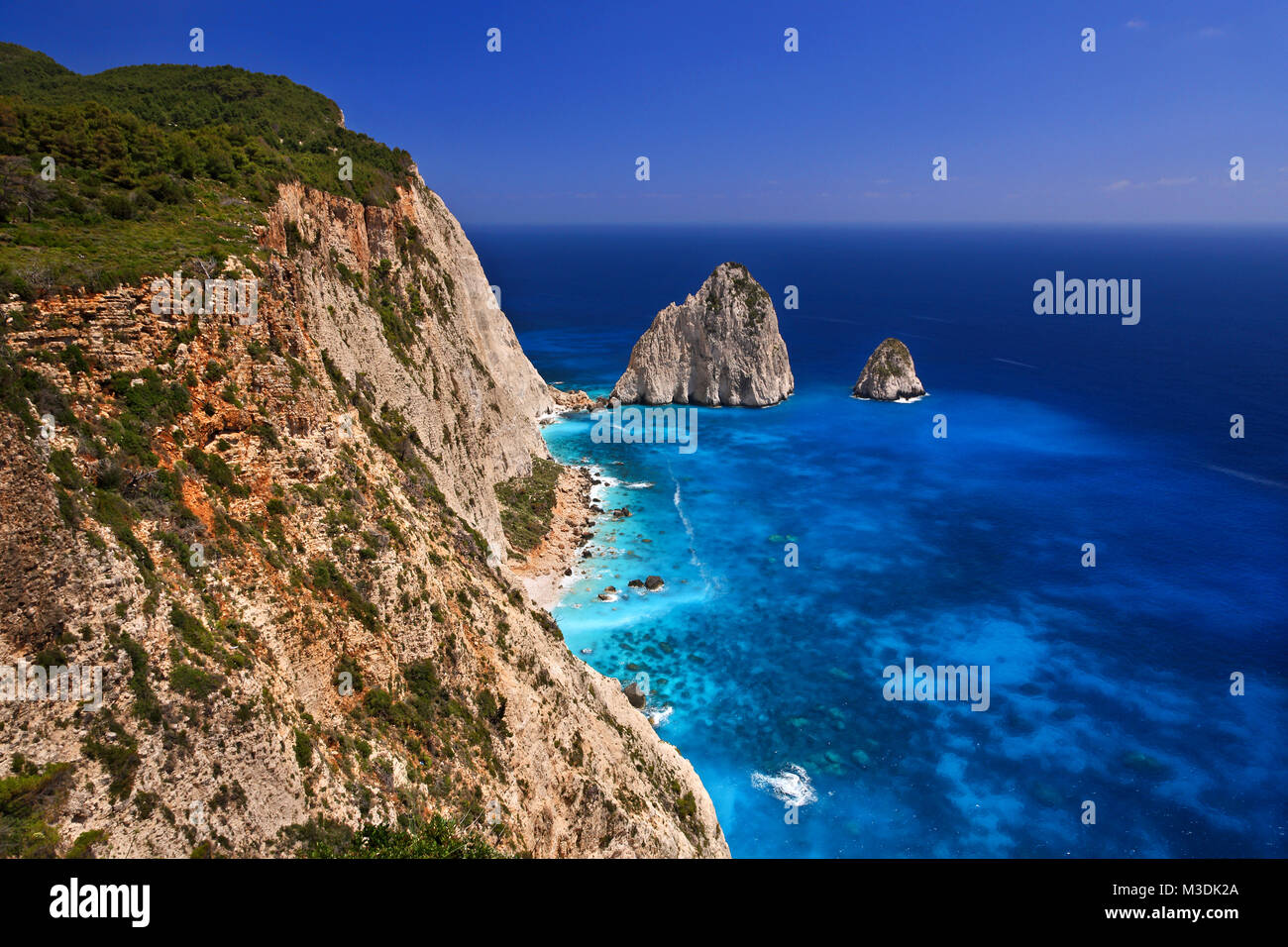Slope over turquoise color waters in Zakynthos, Ionian islands, Greece. - Stock Image