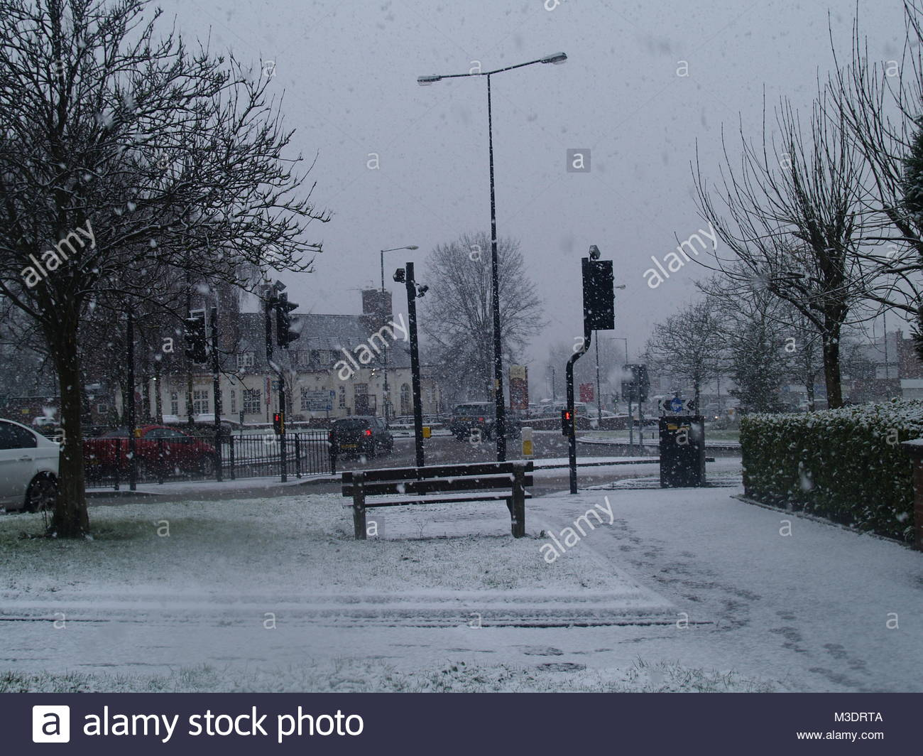 The Traffic Lights Crossing In The Centre Of Aldridge During The Snow Blizzard That Hit The UK - Aldridge, West - Stock Image