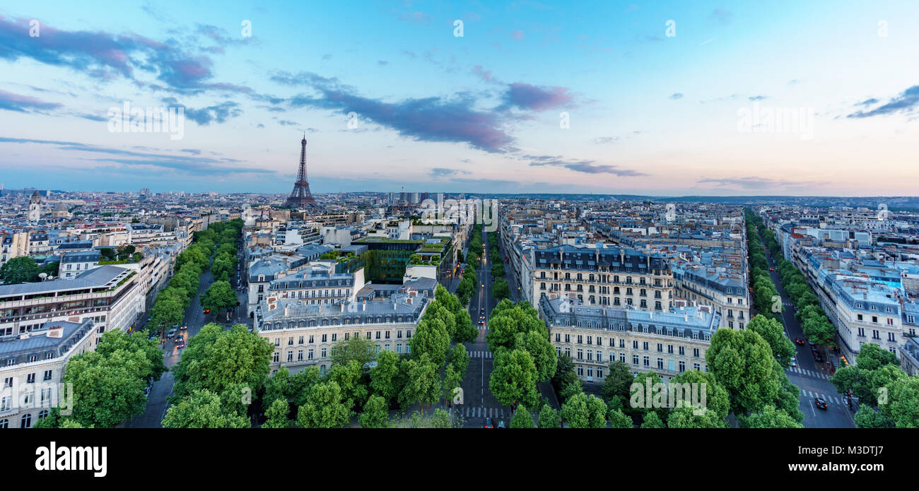Sunset skyline of Paris with Eiffel tower and streets with trees Stock Photo