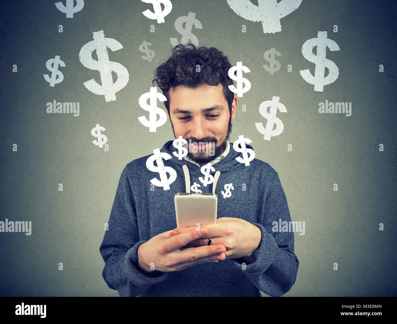 Content young man using smartphone and making business from social media. - Stock Image